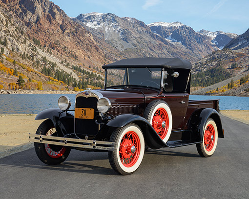 AUT 19 RK1132 01 © Kimball Stock 1930 Ford Model A Roadster Pickup Maroon 3/4 Front View On Pavement By Lake And Mountains