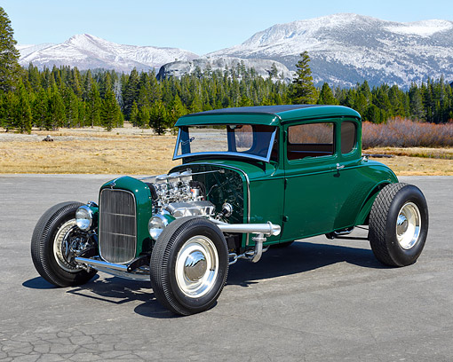 AUT 19 RK1138 01 © Kimball Stock 1930 Ford 5-Window Coupe Green 3/4 Front View In Open Meadow By Mountains