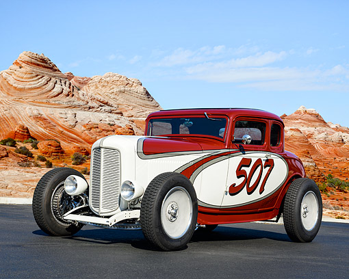 AUT 19 RK1141 01 © Kimball Stock 1932 Ford 5-Window Coupe Red And White In Swirling Desert Winds