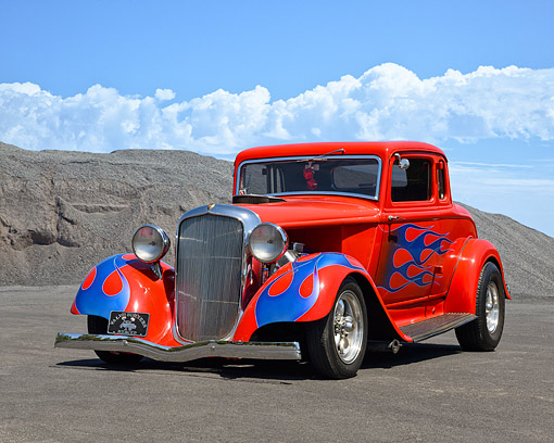 AUT 19 RK1146 01 © Kimball Stock 1933 Plymouth 3-Window Coupe Red In Arid Landscape Under Puffy Clouds