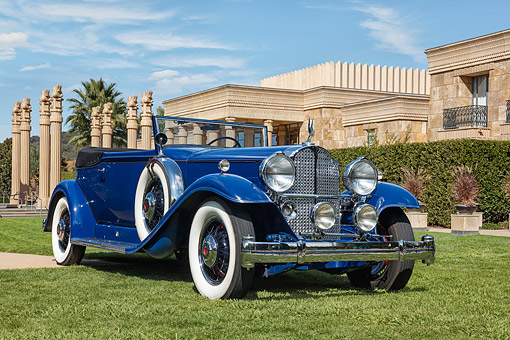 AUT 19 RK1152 01 © Kimball Stock 1932 Packard 903 Victoria Convertible Blue 3/4 Front View On Grass By Building