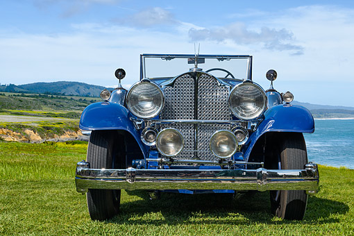AUT 19 RK1153 01 © Kimball Stock 1932 Packard 903 Victoria Convertible Blue 3/4 Front View On Grass By Building