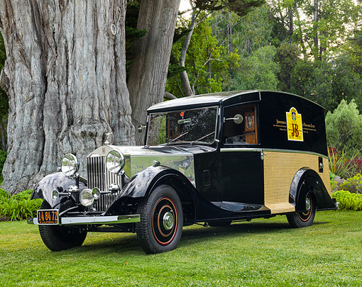 AUT 19 RK1154 01 © Kimball Stock 1933 Rolls Royce One-Of-A-Kind J&B Scotch Whiskey Delivery Van 3/4 Front View On Grass In Trees