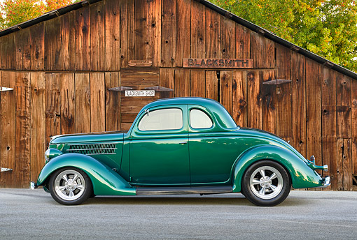AUT 19 RK1159 01 © Kimball Stock 1937 Ford Green Profile View By Blacksmith Shop