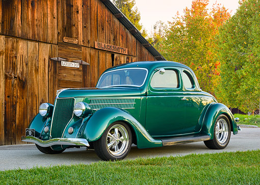 AUT 19 RK1160 01 © Kimball Stock 1937 Ford Green 3/4 Front View By Blacksmith Shop