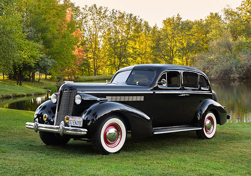 AUT 19 RK1163 01 © Kimball Stock 1937 Buick Black 3/4 Front View On Grass By Lake