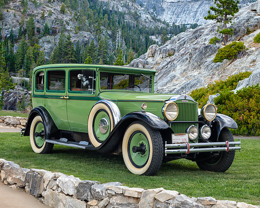 AUT 19 RK1168 01 © Kimball Stock 1930 Packard 726 Eight Sedan Green 3/4 Front View On Grass By Mountains