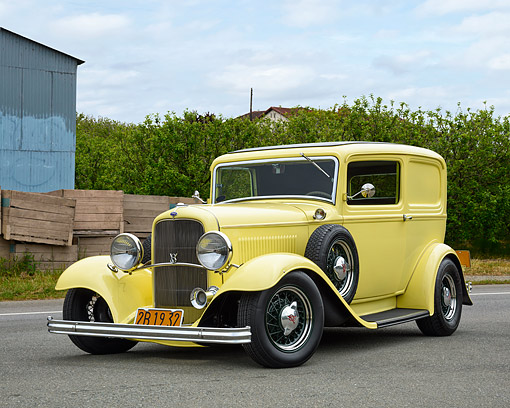 AUT 19 RK1174 01 © Kimball Stock 1932 Ford Sedan Delivery Truck Yellow 3/4 Front View On Road By Trees