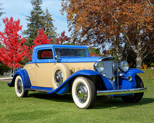 AUT 19 RK1182 01 © Kimball Stock 1931 Marmon V 16 Coupe Blue And Tan 3/4 Front View By Autumn Trees