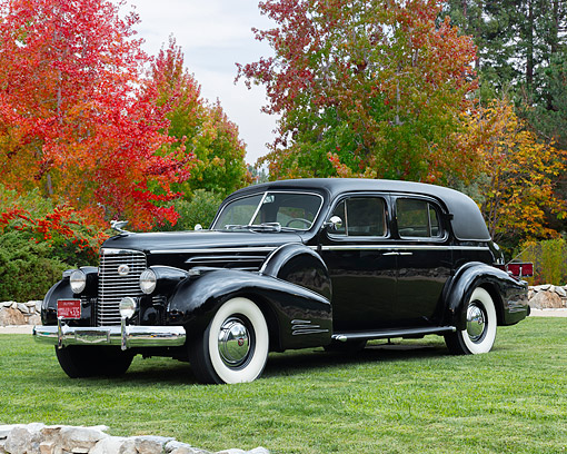 AUT 19 RK1185 01 © Kimball Stock 1938 Cadillac V16 Black 3/4 Front View By Autumn Trees