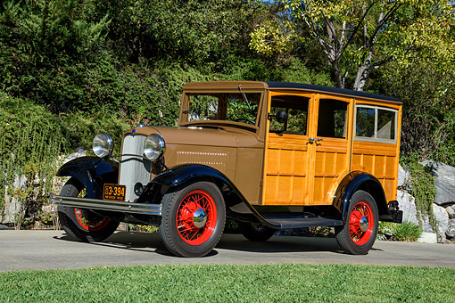 AUT 19 RK1191 01 © Kimball Stock 1932 Ford Station Wagon B-150 Woodie 3/4 Front View By Trees