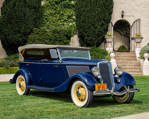 AUT 19 RK1194 01 © Kimball Stock 1934 Ford V8 Deluxe Phaeton Blue 3/4 Front View By Building
