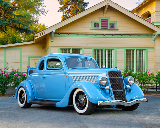 AUT 19 RK1200 01 © Kimball Stock 1935 Ford Model 48 5-Window Coupe Rumble Seat Blue 3/4 Front View By House