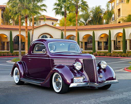 AUT 19 RK1205 01 © Kimball Stock 1936 Ford Model 48 3-Window Coupe Burgundy 3/4 Front View On Pavement By Building And Palm Trees