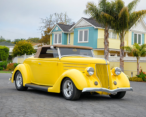 AUT 19 RK1218 01 © Kimball Stock 1936 Ford Model 48 Roadster Yellow 3/4 Front View In Seaside Neighborhood
