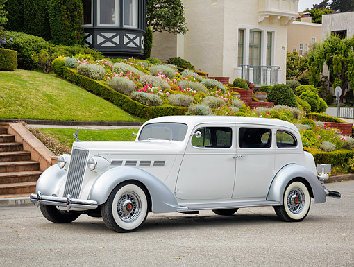 AUT 19 RK1219 01 © Kimball Stock 1937 Packard Super Eight Limousine White And Silver 3/4 Front View In Wealthy Neighborhood