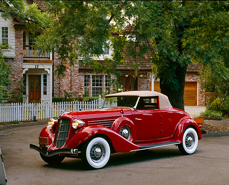 AUT 19 RK0043 04 © Kimball Stock 1936 Auburn Cabriolet Red Side 3/4 View On Pavement By House And Trees