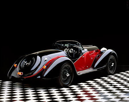 AUT 19 RK0078 06 © Kimball Stock 1939 Alfa Romeo 2500 Super Sport 6C Black And Red 3/4 Rear View On Checkered Floor Studio