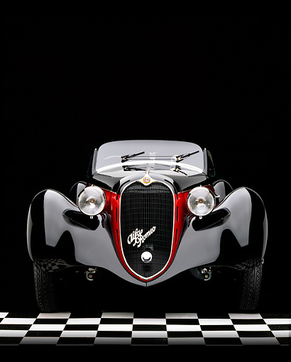 AUT 19 RK0081 04 © Kimball Stock 1939 Alfa Romeo 2500 Super Sport 6C Black And Red Heads On Shot Checkered Floor Studio