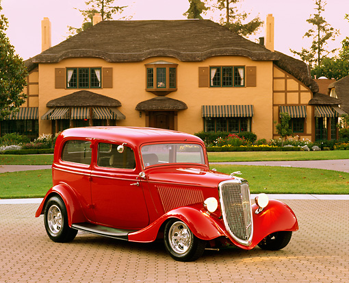 AUT 19 RK0087 03 © Kimball Stock 1934 Ford Tudor Sedan Red 3/4 Front View By House