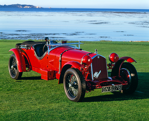 AUT 19 RK0131 05 © Kimball Stock 1931 Alfa Romeo 8C 2.3 Le Mans Red 3/4 Front View On Grass By Ocean