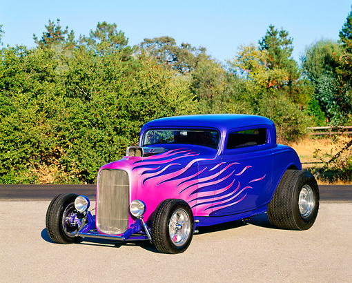 AUT 19 RK0163 05 © Kimball Stock 1934 Ford Coupe Purple With Flames Hot Rod 3/4 Front View By Trees