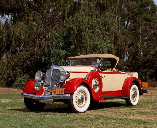 AUT 19 RK0211 04 © Kimball Stock 1934 Chrysler Roadster Red And Beige 3/4 Front View On Grass By Trees