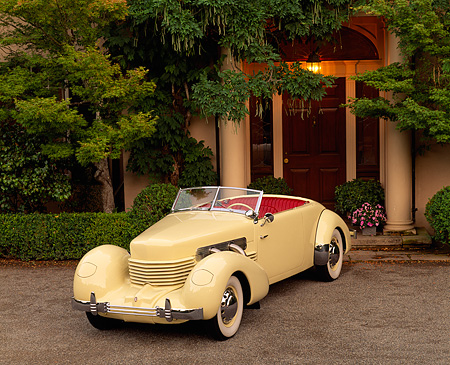 AUT 19 RK0239 06 © Kimball Stock 1937 Cord 812 Supercharged Phaeton Convertible Yellow Front 3/4 View By Trees