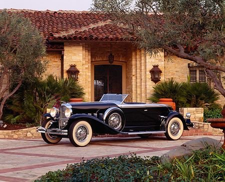 AUT 19 RK0252 19 © Kimball Stock 1930 Black Duesenberg (Murphy Body) soft 3/4 front in driveway with house as background