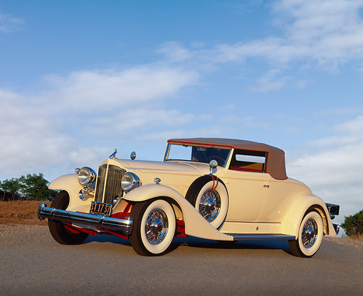 AUT 19 RK0256 04 © Kimball Stock 1933 Packard V-12 Coupe White 3/4 Side View On Pavement Blue Sky