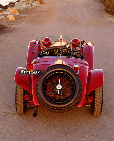 AUT 19 RK0258 01 © Kimball Stock 1932 Alfa Romeo 2300 Touring Spider 8C Red Rear Shot On Pavement