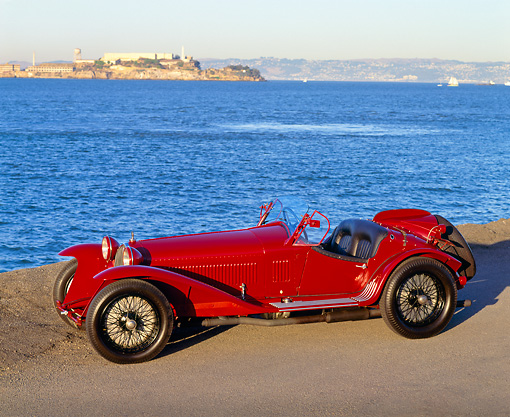 AUT 19 RK0261 04 © Kimball Stock 1932 Red Alfa Romeo 8C 2300 Touring Spider 3/4 Front View By Water