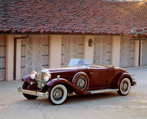 AUT 19 RK0279 04 © Kimball Stock 1932 Packard Dietrich 8C Convertible Burgundy 3/4 Front View By Garage