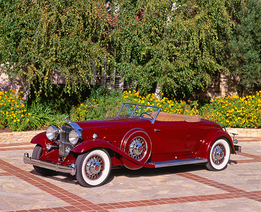 AUT 19 RK0280 06 © Kimball Stock 1932 Packard 8C Dietrich Red 3/4 Front On Driveway By Trees And House