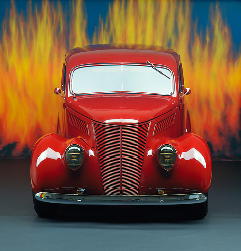 AUT 19 RK0294 09 © Kimball Stock Ford Roadster Red Front View In Studio With Flames