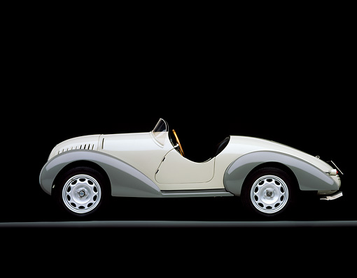 AUT 19 RK0299 07 © Kimball Stock 1938 Siata Zagato Cream Side View On Gray Line Studio