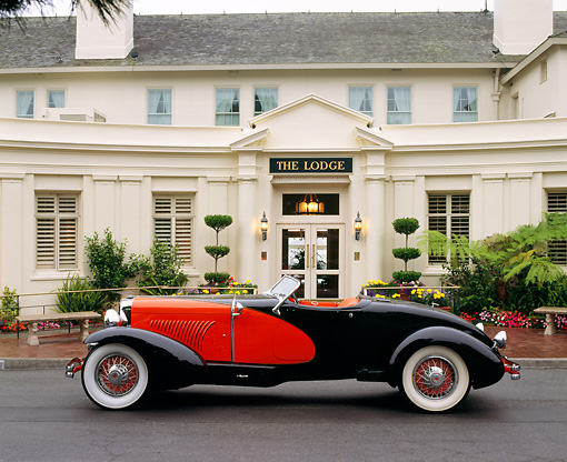 AUT 19 RK0304 01 © Kimball Stock 1931 Duesenberg Model J Red And Black Convertible Profile View On Pavement By Lodge