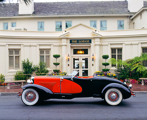 AUT 19 RK0304 10 © Kimball Stock 1931 Duesenberg Model J Red And Black Convertible Profile View On Pavement By Lodge
