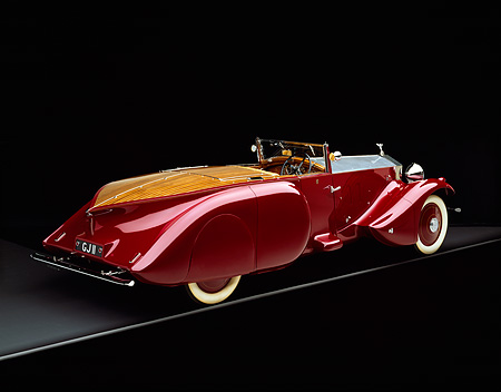 AUT 19 RK0321 09 © Kimball Stock 1930 Rolls Royce Boat-tail Convertible Burgundy 3/4 Rear View On Gray Line Studio