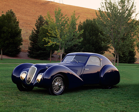 AUT 19 RK0335 04 © Kimball Stock 1939 Talbot Lago 150C-SS Aerodynamic Coupe Blue 3/4 Side View On Grass