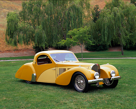 AUT 19 RK0342 02 © Kimball Stock 1937 Bugatti Type 57 Atlante Coupe Yellow 3/4 Side View On Grass