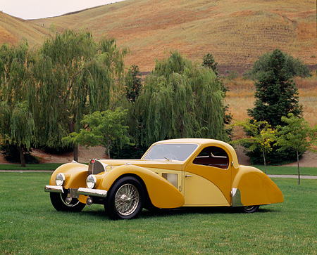 AUT 19 RK0345 03 © Kimball Stock 1937 Bugatti Type 57 Atlante Coupe Two Tone Yellow 3/4 Front View On Grass