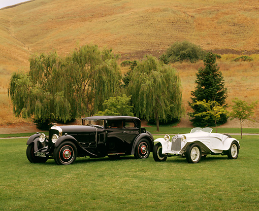 AUT 19 RK0349 01 © Kimball Stock 1930 Bentley Speed Six Corsica Coupe And 1931 Alfa Romeo 6C 1750 GS