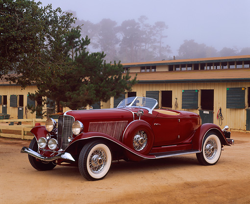 AUT 19 RK0352 08 © Kimball Stock 1933 Auburn Salon Bobtail Speedster V-12 Burgundy 3/4 Side View On Dirt By Horse Salon