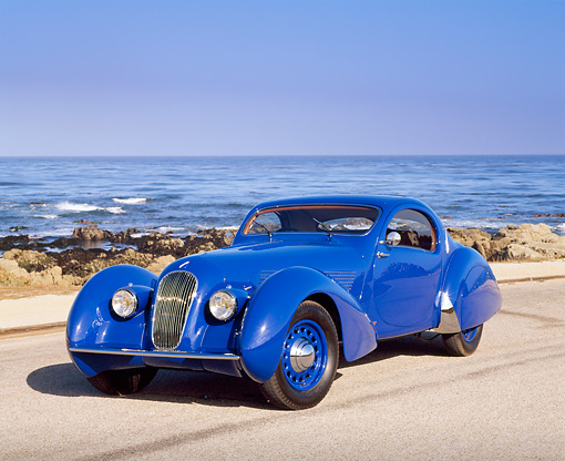 AUT 19 RK0357 04 © Kimball Stock 1937 Talbot Lago Blue 3/4 Front View On Pavement By Ocean Blue Sky