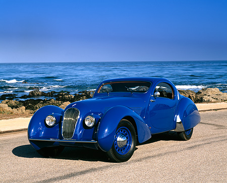 AUT 19 RK0357 05 © Kimball Stock 1937 Talbot Lago Blue 3/4 Front View On Pavement By Ocean Blue Sky