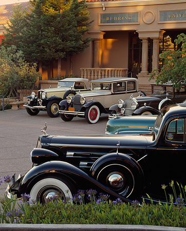 AUT 19 RK0369 08 © Kimball Stock 1930, 1931, 1937, 1941 Cadillacs and 1931 Studebaker On Pavement By Building