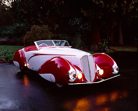 AUT 19 RK0371 06 © Kimball Stock 1937 Delahaye Type 135 Competition Court Built By Figoni And Falaschi Red And Gray 3/4 Side On Wet Pavement