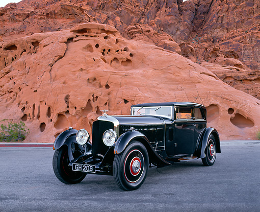 AUT 19 RK0416 01 © Kimball Stock 1930 Bentley Speed Six Corsica Coupe Black 3/4 Front View On Pavement By Red Rocks