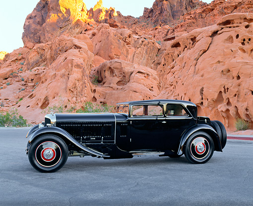 AUT 19 RK0417 02 © Kimball Stock 1930 Bentley Speed Six Corsica Coupe Black Side View On Pavement By Red Rocks